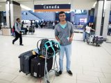 Carleton International student Rajarshi Bose is greeted at the Ottawa International Airport in Sept. 2016