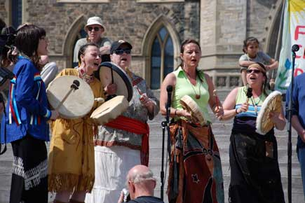 A group of Aboriginal Singers performs on Parliament Hill.
