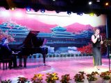 """Kelsey Hayes sings """"Valentine's Day without a valentine,"""" with Matthew Devost accompanying on piano at Huaihua University"""