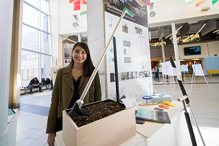 A student shows off her project in the Galleria during the Industrial Design Graduation Exhibition in April 2017