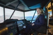 "Transport Minister ""Flies"" Carleton's Helicopter Simulator during Aerospace Tour"