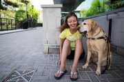 Spring Convocation: Canine Companion Helps Out