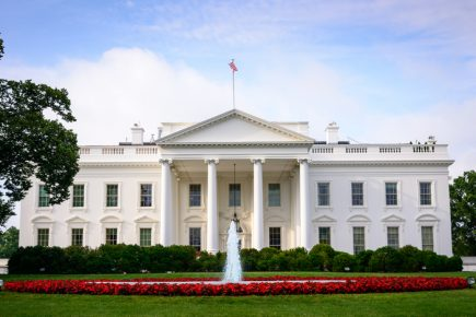 A photo of the White House in summer.