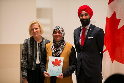 A member of The A-List poses with Carleton President Runte and Minister Navdeep Bains