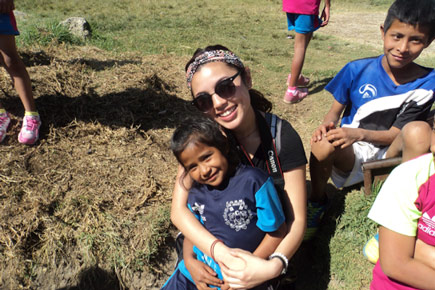 An Alternative Spring Break participant spends time with children in the community