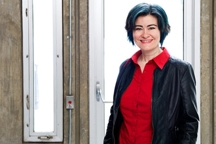 Water and Global Health researcher Banu Ormeci, pictured here wearing a jacket and a bright red shirt, is the new Jarislowsky Chair .