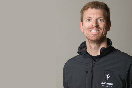 Brian Hill is pictured in a Ravens Swimming jacket