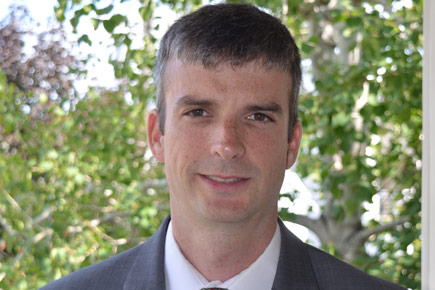 Brain Payne, one of Carleton's Fulbright Scholar, is pictured here in a headshot.