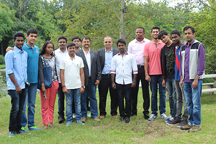 11 students from one of India's top engineering colleges pose for a picture at the Rideau River during a four-week internship organized by Carleton's Canada-India Centre for Excellence.