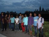 The visiting Indian students pose together at Major's Hill Park in the evening, with Parliament Hill in the backdrop.