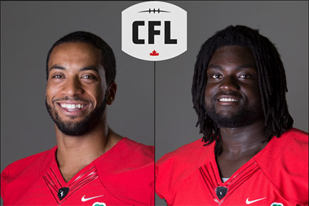 Carleton Ravens football players Nate Behar (left) and Kwabena Asare pose for their team photos in jerseys.