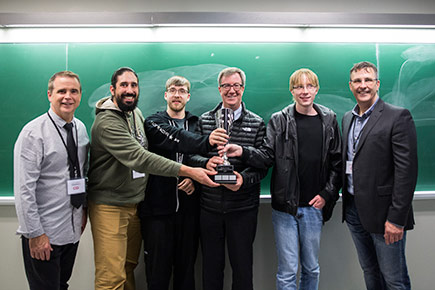 The winners of the Cyber Security Challenge hold their trophy with Mayor Jim Watson.