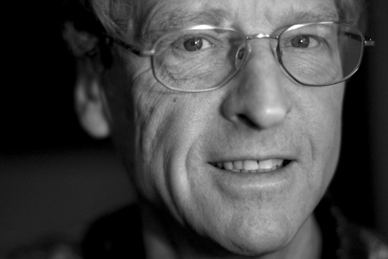 A close-up black and white shot of Astrophysics Researcher David Sinclair.