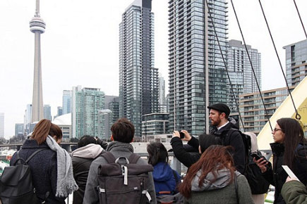 Students taking part in the Dialog studio experience analyze the skyline in downtown Toronto.