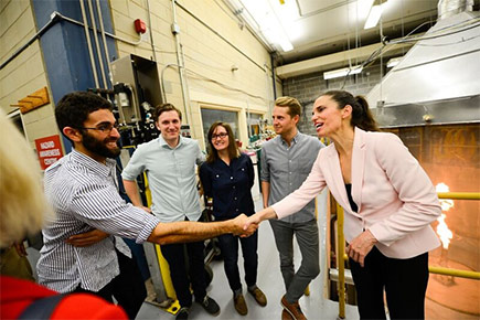 Federal Science Minister Kirsty Duncan, shaking hands with David Sawires. Bradley Conrad, Melina Jefferson and Darcy Corbin are standing behind them.
