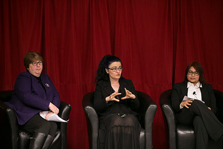 Women participate in a panel on International Women's Day