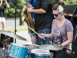 Justine Walker plays the drums in front of the carillon