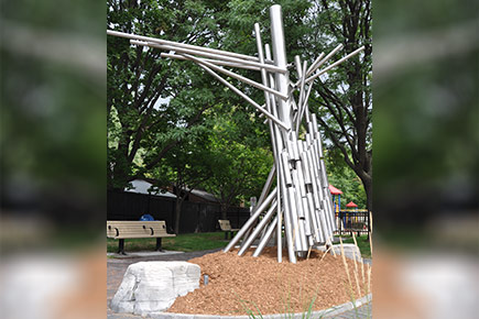 Carleton art duo Jesse Stewart and Matt Edwards created a scuplture called the Listening Tree, pictured here on a summer day in a playground.