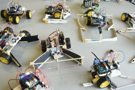 Ontario Engineering Competition: Robots made during the competition are laid out on a table