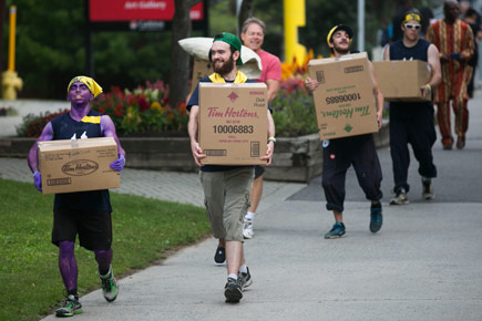 Students carry boxes during Residence move-in day in 2014.