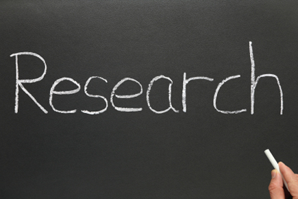 The word research, written on a blackboard.