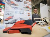 A student shows off his project in the Galleria during the Industrial Design Graduation Exhibition in April 2017