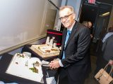 Department Chair Ron Saunders cuts a cake during the 50th anniversary celebrations of the Law and Legal Studies Program.