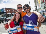 Three Carleton Shinerama participants pose together while holding their donation boxes on a sunny day.