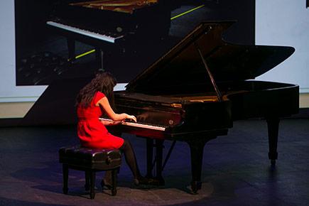 Student Anita Pari performs a piece on Van Cliburn's piano.