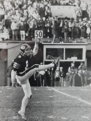 Jeff Morris kicks a punt during the Panda Game in 1983.