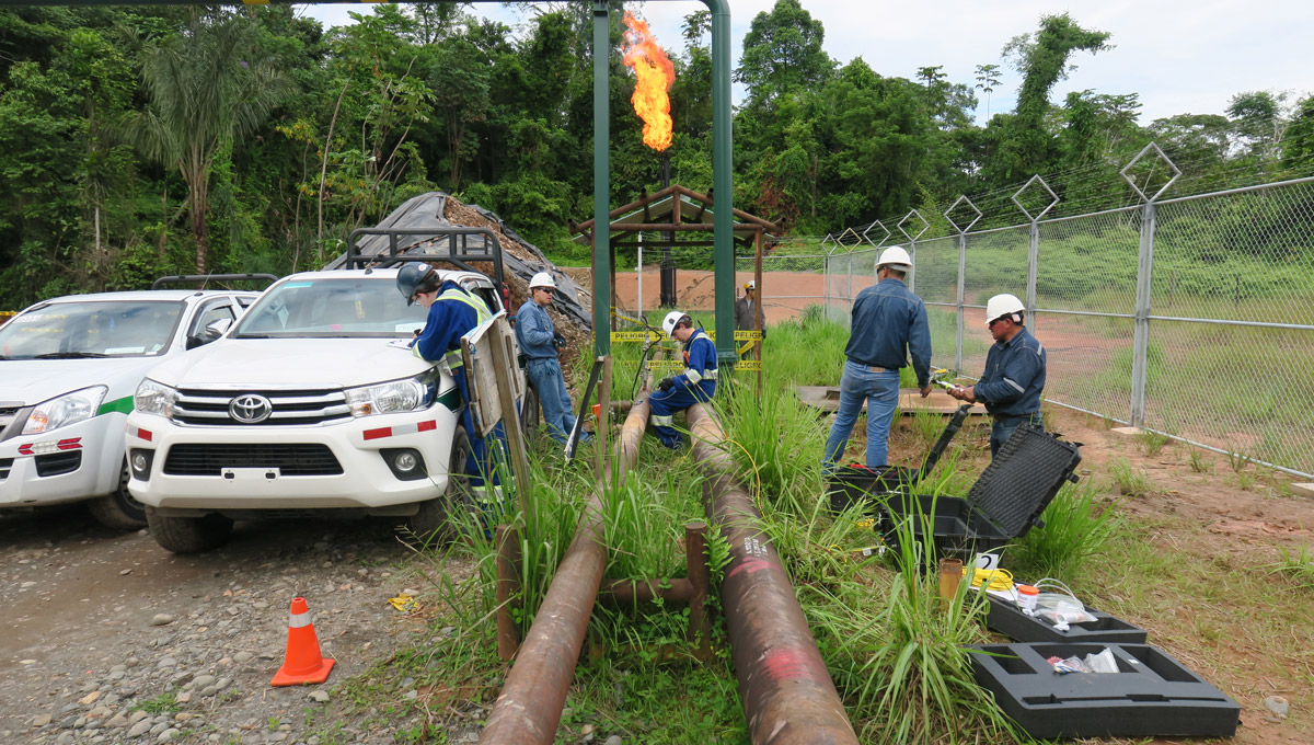 The FlareNet sets up their equipment next to an oil and gas line in Ecuador.