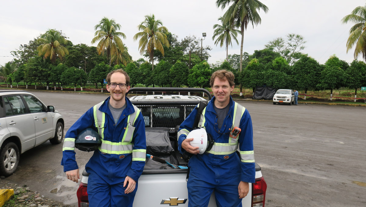 Members ot the FlareNet team lean up against a vehicle in Ecuador.