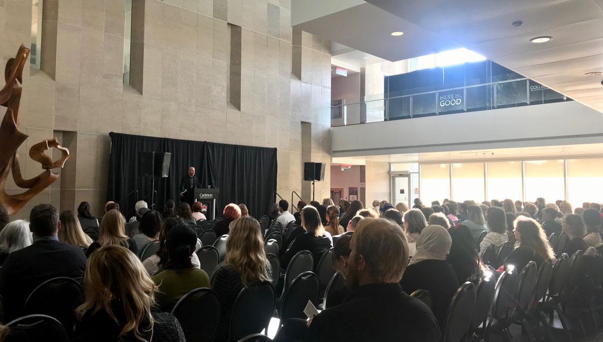 President Benoit-Antoine Bacon speaks at the Psychology Mental Health Day.