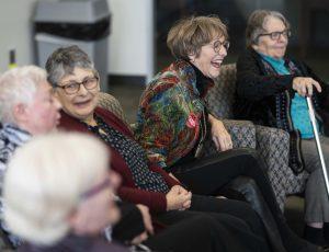 Women participate in a panel discussion on Carleton unionization