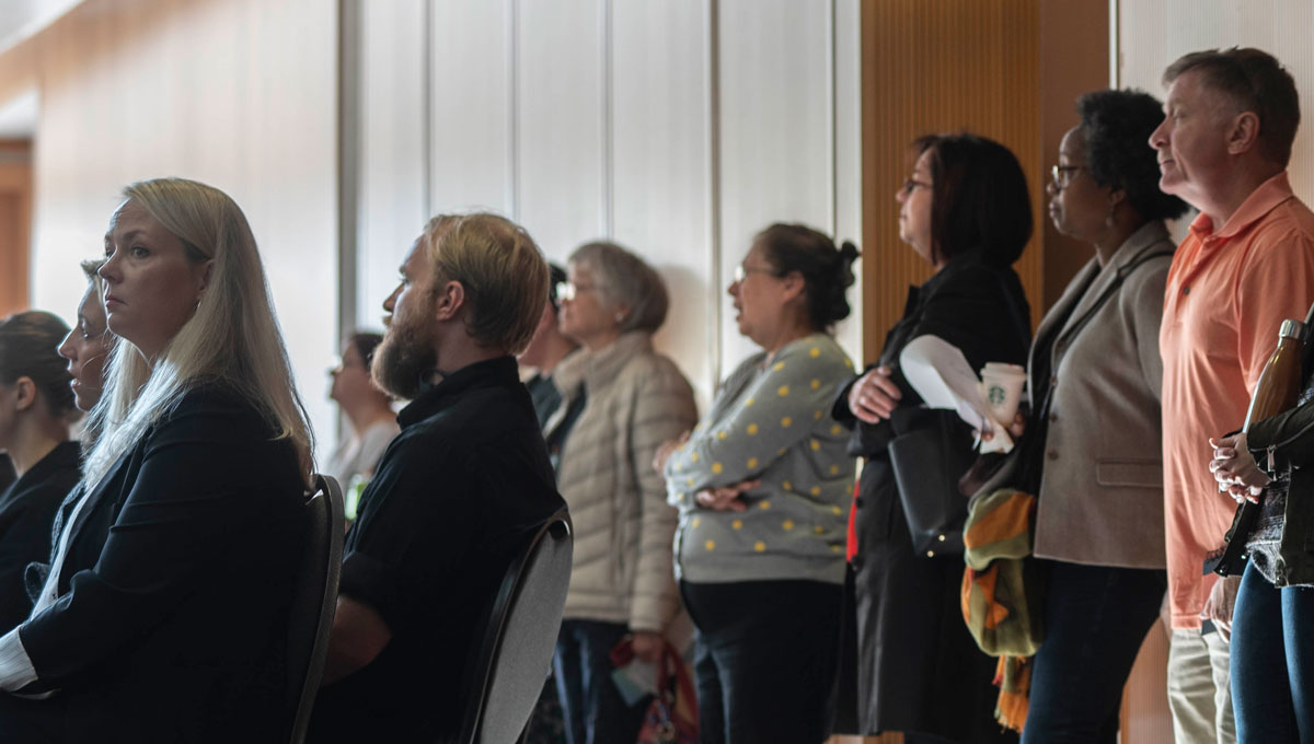 A crowd of attendees listen to presentations at the Psychology Mental Health Day.