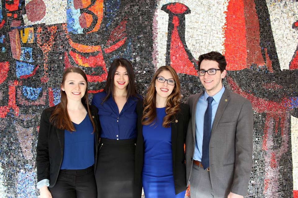 Cassie Lee poses in the foyer of the Tory Building with her Sprott Competes teammates.