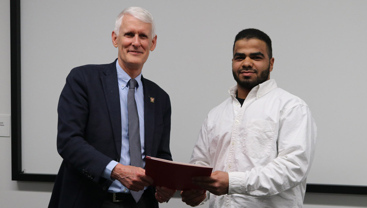 Mohamed Hozayen receives the Provost Scholar Award from Provost and Vice-President (Academic) Jerry Tomberlin in April 2019