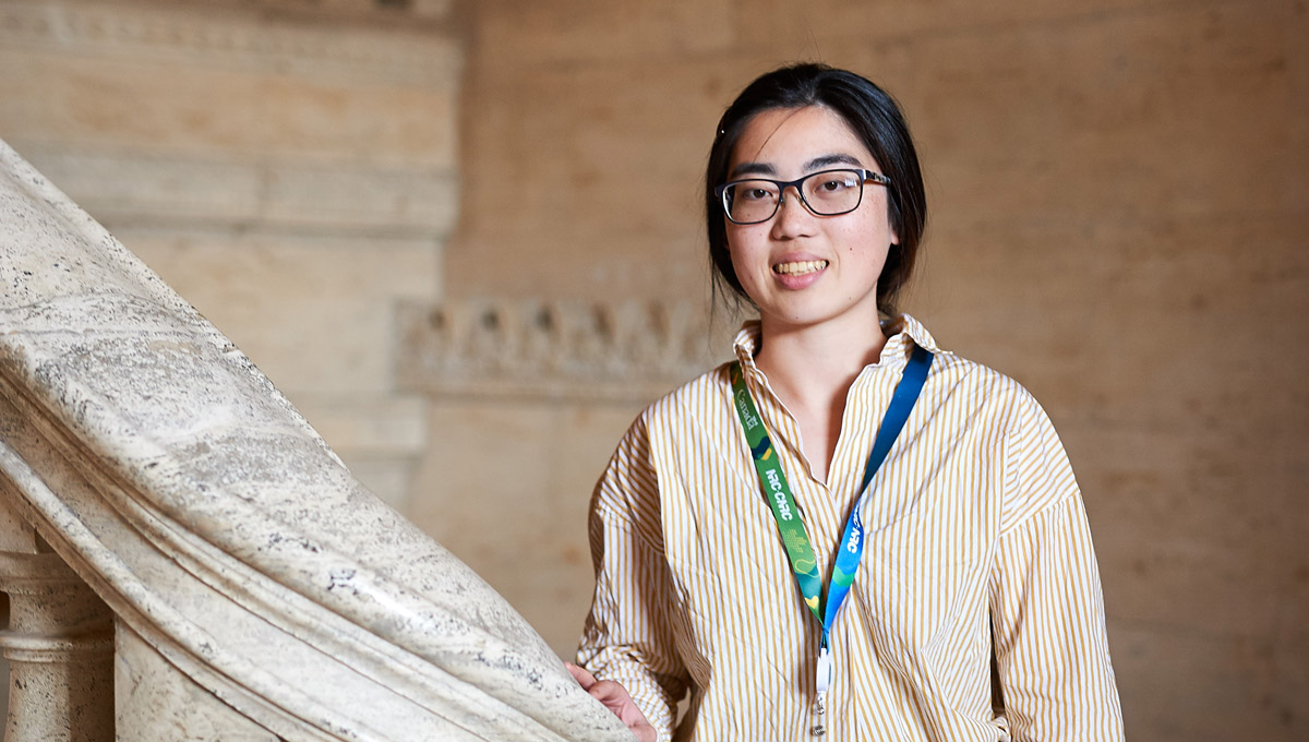 Vivian Chu poses on a marble staircase.
