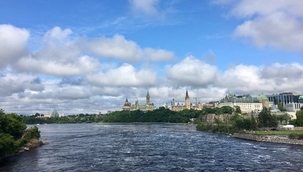 View of the Ottawa River flowing towards Parliament Hill taken from the Portage Bridge which connects the cities of Ottawa and Gatineau.