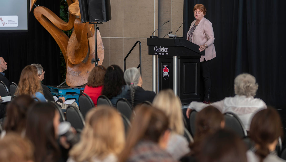 Pauline Rankin addresses attendees at Psychology Mental Health Day.