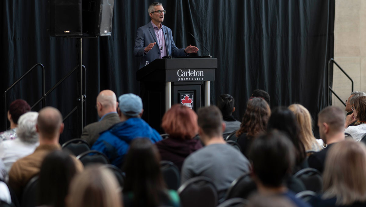 Michel Dugas speaks during his presentation at Psychology Mental Health Day.