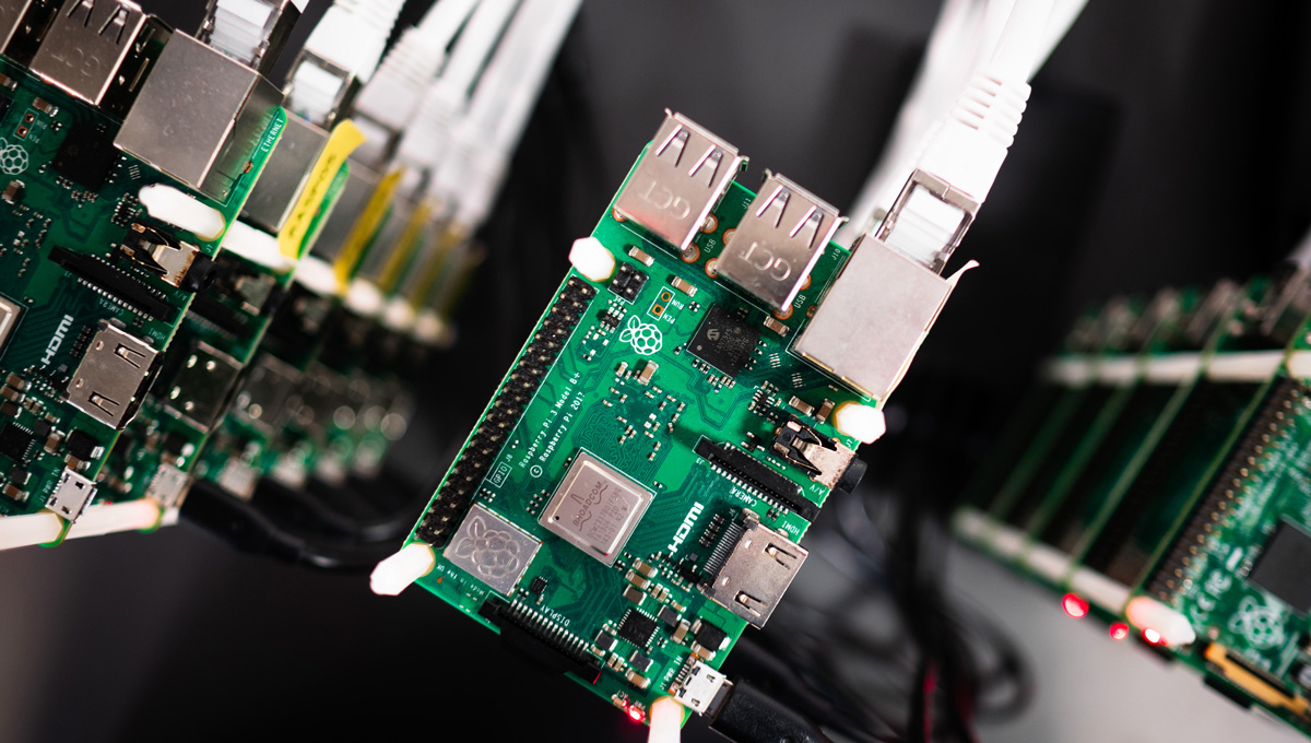 Raspberry Pi boards connected to cables.