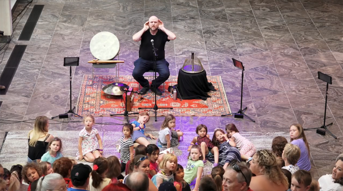Jesse Stewart performs at the NAC with an audience of children and their families as part of the We Are All Musicians Project.
