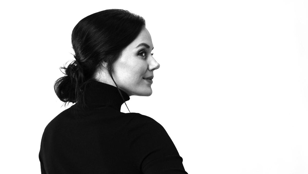 A black and white headshot of Tessa Virtue