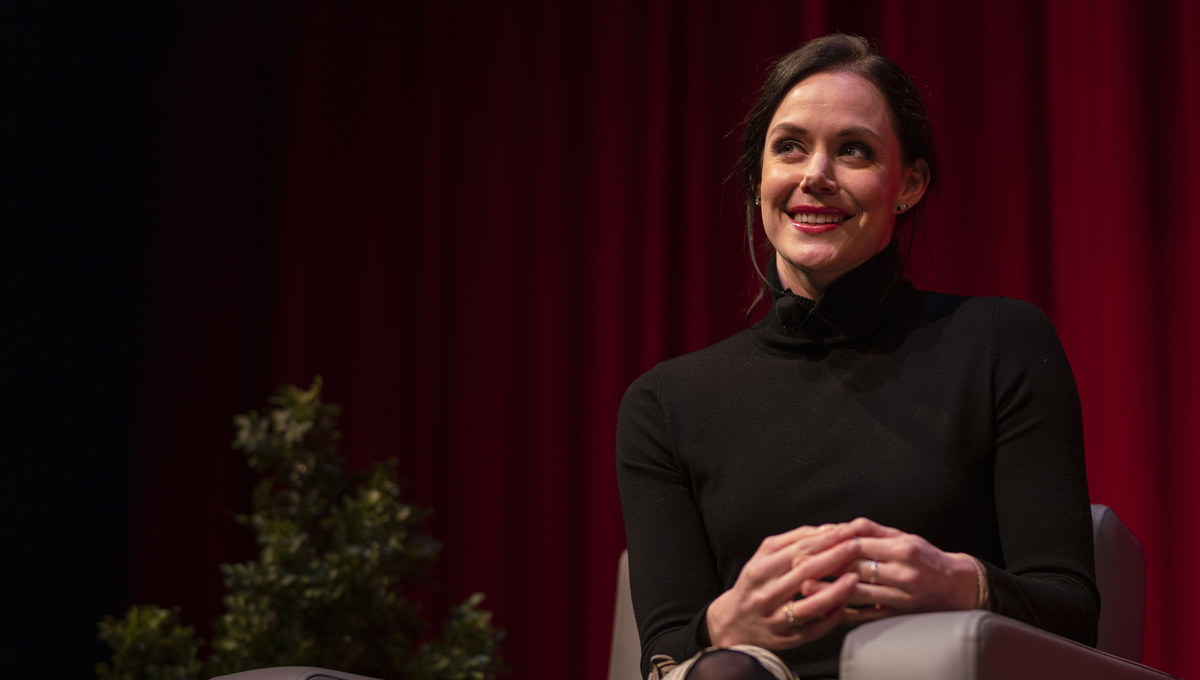 Tessa Virtue smiles at the audience from the stage.