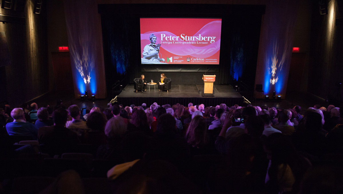 A wide angle view from the vantage point of the audience as Adrienne Arsenault and Kristy Kirkup sit together on-stage for a post-lecture interview