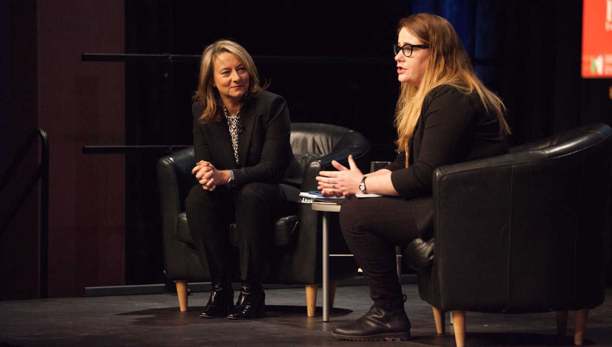 Adrienne Arsenault and Kristy Kirkup sit together on-stage for a post-lecture interview/