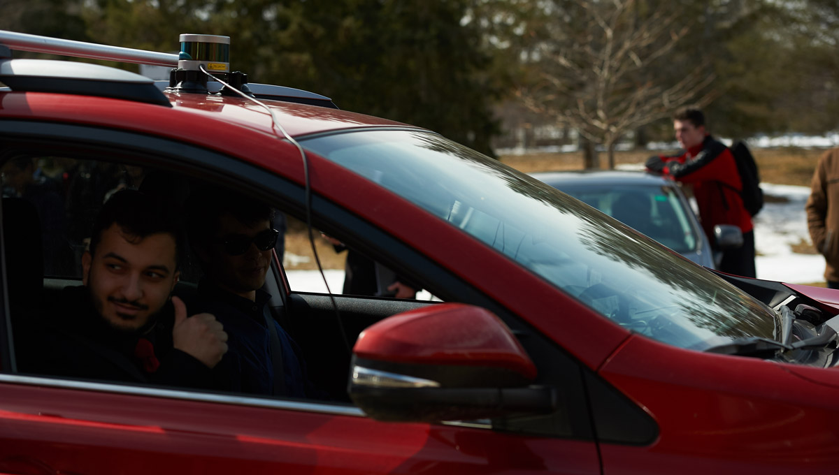 A student gives the thumbs-up during the Autonomous Vehicles demonstration.