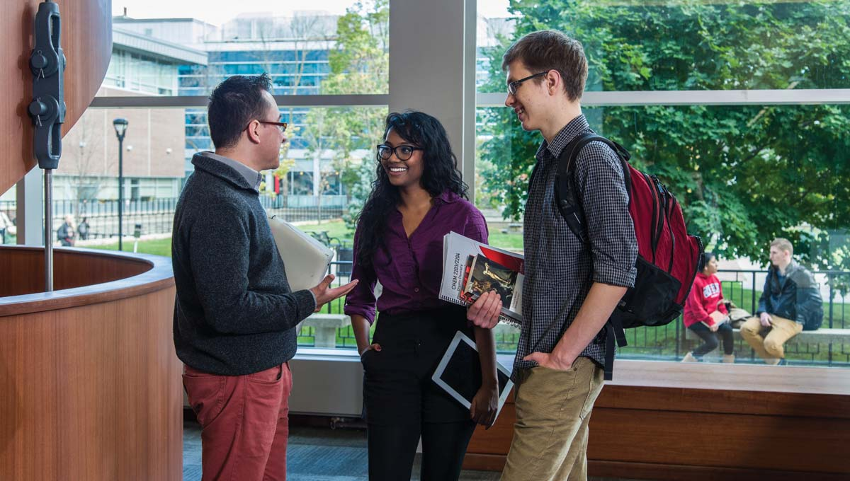 Students, who will benefit from new Carleton programs in 2016 - '17, meet up together in the Library.