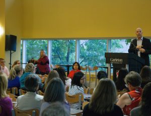 Attendees of the Carleton Community Breakfast listen to an address by President Bacon.